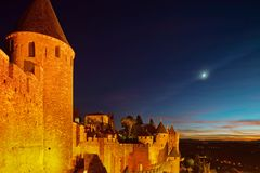 Carcassonne medieval fortress highlighted night view with moon i Royalty Free Stock Photos