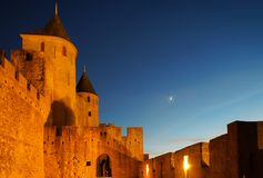 Carcassonne medieval fortress highlighted night view with moon i Royalty Free Stock Images