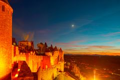 Carcassonne medieval fortress highlighted night view with moon i Stock Photo