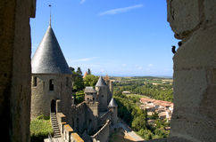 Carcassonne's walls. Defensive towers and walls of the Cite of Carcassonne on the plain of Aude Stock Photo