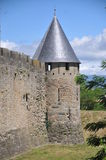 Carcassonne Town Wall. This is part of the town wall of the medieval town of Carcassonne in southern France. Right next you can see the moat surrounding the town Royalty Free Stock Images