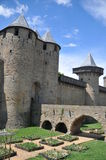 Carcassonne. View of the old bridge of Carcassonne and the medieval town walls with its towers from inside the city walls Stock Photography
