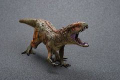 Carcharodontosaurus toy. On a dark background Royalty Free Stock Image