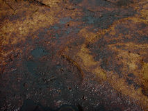 Carcinogenic crude oil pollution produced by illegal oil mining Stock Photos