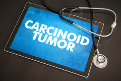 Carcinoid tumor (cancer related) diagnosis medical concept on ta. Blet screen with stethoscope stock photography
