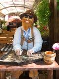 Carácter móvil bávaro que toca la cítara Foto de archivo