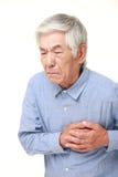 Cardíaco de ataque japonês superior do homem Fotografia de Stock Royalty Free