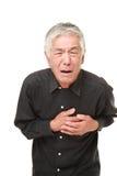 Cardíaco de ataque japonês superior do homem Fotos de Stock