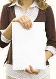 Card. Paper clean sheet in hands in the girl Stock Photos