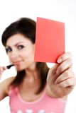 Card. An image of a woman showing red card Royalty Free Stock Images