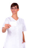 Card. Nurse woman with glasses holding card in his hands stock photos