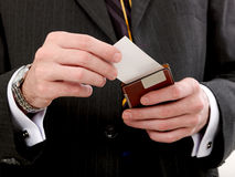 Card. Businesses man giving you a visiting card stock image