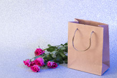 Card with bag and roses Stock Photography