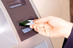The card into the ATM machine. Eastphoto, tukuchina, The card into the ATM machine, Body, closeup Royalty Free Stock Photo