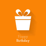 Card for birthday with a white gift box on orange background Royalty Free Stock Photos