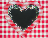 Card blank in heart shape with confetti Royalty Free Stock Image