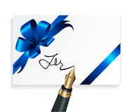 Card with blue gift bow and signing with a fountain pen Stock Photo