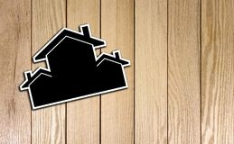 Houses Shape Card board on Wood Texture. Photo Image Royalty Free Stock Image