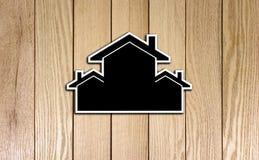 Houses Shape Card board on Wood Texture. Photo Image Stock Photo