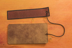 Card board and leather board. Tied with brown string on wooden background Stock Image