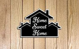 Houses Shape Card board Home Sweet Home on Wood Texture. Photo Image Royalty Free Stock Photo