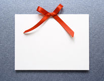 Card with bow of red ribbon Royalty Free Stock Images