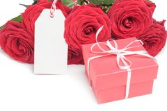 Card, box and roses on white Royalty Free Stock Photos