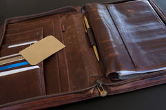 Card on a briefcase. Gold vip card on leather briefcase Royalty Free Stock Image