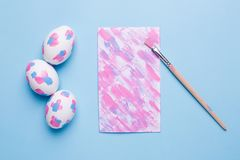Card ,brush and easter eggs with watercolor brushstrokes stock images