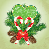 Card with candys in heart shape and fir-tree branches. Hand writ Stock Image
