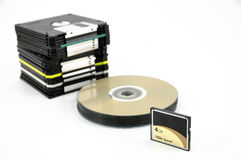 Card, cd, floppy. Storage devices on white background with focus on flash card stock image