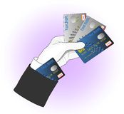 Card cheat. White-gloved magician holds 3 credit/debit cards and hides one card in his sleeve – an old well-known trick of magicians and cardsharpers. Image Stock Photo