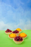 Card with cherry, peach and jelly tarts Stock Images