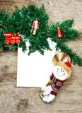 Card with Christmas toys. On wooden background Royalty Free Stock Photography