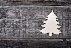 Card with  Christmas tree. On wooden background Royalty Free Stock Photography