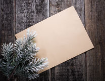 Card with  Christmas tree. On wooden background Stock Photo