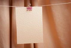 Card on the clothespin Stock Photos