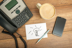 Card with Conceptual Light Drawing on Worktable Royalty Free Stock Photo