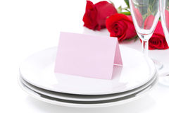 Card for congratulation on a plate, roses and glasses Royalty Free Stock Photos