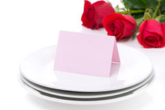 Card for congratulation on a plate and roses for Valentine's Day Stock Photography