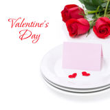 Card for congratulation on a plate and roses for Valentine's Day. Isolated on white Royalty Free Stock Photography