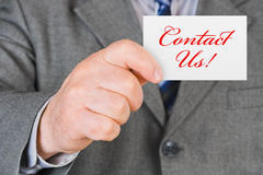 Card Contact us in hand. Business background Royalty Free Stock Image