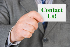 Card Contact us in hand. Business background Stock Images