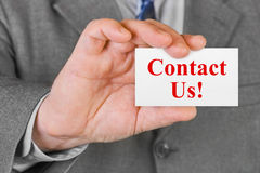 Card Contact us in hand Stock Photos