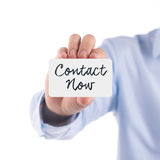 Card Contact us in hand Royalty Free Stock Image
