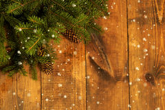 Card corner. Christmas Corner - a strip of fresh fluffy fir branches with cones on a wooden background stock images