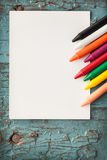 Card and crayons. On wooden boards royalty free stock photography