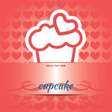 Card with a cream cake with a red heart on top over a red background Stock Images