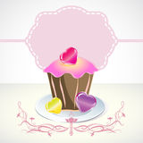 Card with cupcake and hearts. And label Stock Photos