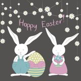Card with cute Easter Bunnies, colorful easter eggs, camomile garland. Vector Illustration. perfect to easter banner, poster, label, card and other Easter royalty free illustration